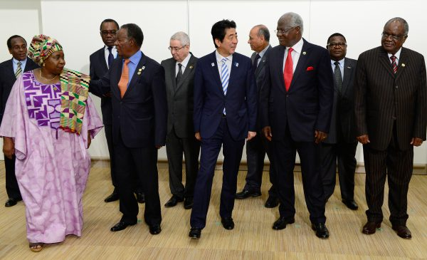 Japanese Prime Minister Shinzo Abe (front C) escorts Sierre Leonean President Ernest Bai Koroma (front 2nd R), Chairperson of the African Union Commission Nkosazana Dlamini-Zuma (front L) and other representatives from African countries prior to the Japan-Africa summit meeting on United Nations Security Council reform during the Tokyo International Conference on African Development (TICAD) in Yokohama, suburban Tokyo, on June 3, 2013. Japan said on June 2 it would give one billion USD in aid to help stabilise the Islamist-infested Sahel region of Africa, months after the deaths of 10 Japanese in a hostage crisis there. AFP PHOTO / Toru YAMANAKA