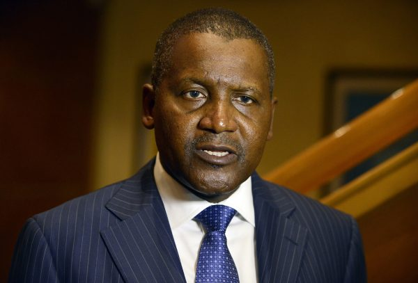 Business magnate man Aliko Dangote, ranked by Forbes Magazine as the richest man in Africa, speaks during a send off ceremony of 250 Nigerian health workers on a mission to fight Ebola virus in affected West African countries and launch of African initiative operating under the hash tag #AfricaAgainstEbola in Lagos on December 3, 2014. Two hundred and fifty volunteer Nigerian medical corps under the auspices of the African Union Support to Ebola Outbreak in West Africa (ASEOWA) were given a send off to fight Ebola Virus Diseases in the affected three West African countries of Liberia, Sierra Leone and Guinea. The African Union, which is collaborating with the private sector to raise funds to support and strengthen the Unions response to the crises, is sending more than 1000 health workers before Christmas. AFP PHOTO/PIUS UTOMI EKPEI (Photo credit should read PIUS UTOMI EKPEI/AFP/Getty Images)