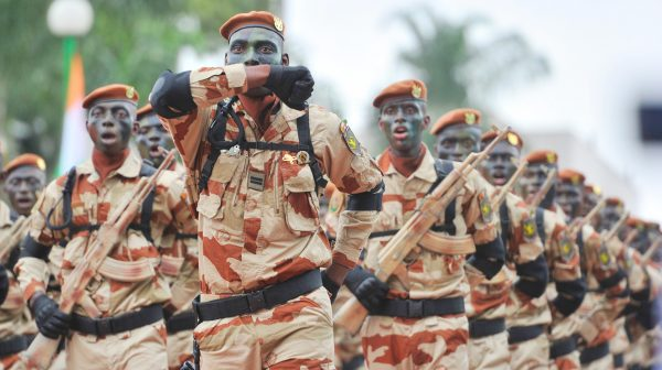The members of Ivory Coast's special forces march, on August 7, 2013, at the presidential palace in Abidjan during celebrations marking the 53nd anniversairy of the country's independence from France. AFP PHOTO / ISSOUF SANOGOISSOUF SANOGO/AFP/Getty Images