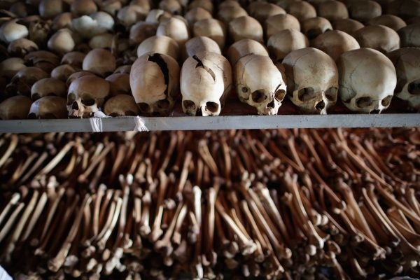 NTARAMA, RWANDA - APRIL 04: Showing signs of extreme trauma, victims' skeletal remains are displayed on metal racks inside the Ntarama Catholic Church genocide memorial ahead of the 20th anniversary of the country's genocide April 4, 2014 in Nyamata, Rwanda. Attackers used grenades to blast their way inside the church on April 14 and 15, 1994 where 5,000 people had taken refuge, killing men, women and children. The church was turned into a memorial site and contains the remains, the majority of them Tutsi, of those who were massacred inside the church itself. (Photo by Chip Somodevilla/Getty Images) ORG XMIT: 482982925